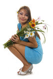 Woman and flowers Stock Photos