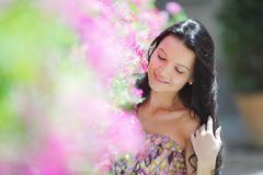 Woman in flowers Stock Image