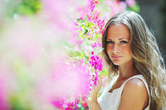 Woman in flowers Royalty Free Stock Photo