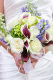 Woman with flowers. Woman in wedding dress with bouquet of flowers Royalty Free Stock Photos