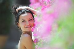 Woman in flowers Stock Images