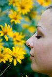 Woman with flowers. In the garden Royalty Free Stock Images