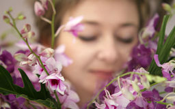 Woman with flowers. Woman enjoying her flowers Stock Photos