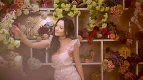 Woman and flowers. Asian girl with bouquets stock video