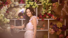 Woman and flowers. Asian girl with bouquets stock video footage