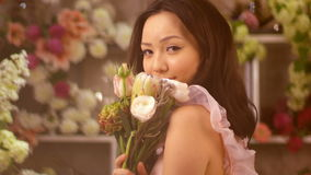 Woman and flowers. Asian girl portrait with bouquet stock video footage