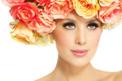 Woman With Flowers. Beautiful woman with flower crown. Bright eyes and glowing skin Stock Images
