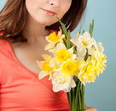 Woman with flowers on blue background Stock Photography