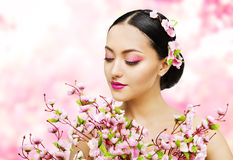 Woman Flowers Bunch Pink Sakura, Girl Makeup Beauty Portrait. Asian Model Fashion Face Make up, Floral Background royalty free stock images