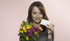 Woman with flowers and card Royalty Free Stock Photo