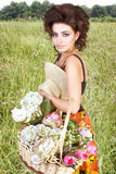 Woman with flowers in the field Royalty Free Stock Photos