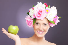 Woman with flowers and green apple Royalty Free Stock Photos
