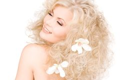 Woman with flowers in hair Stock Image
