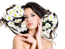 Woman with flowers in hair. Beautiful sexy woman with  flowers in her long hair - white background Royalty Free Stock Photos
