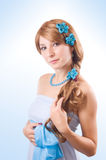 Woman with flowers in hair Royalty Free Stock Photography