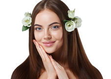 Woman with flowers in hair beautiful portrait with long amazing hair. stock photos