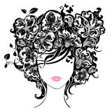 Woman with flowers in hair. Illustration has abstract floral elements, leaves, butterflies, patterns. Isolated on a white background Stock Image