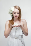 Woman with flowers in a hair Royalty Free Stock Image