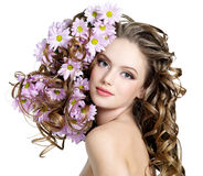 Woman with flowers in hairs. Beautiful young woman with flowers in hairs - white background