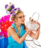 Woman with flowers hairstyle in easter basket keeps bunny. Stock Photography