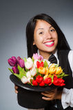 The woman with flowers in hat Royalty Free Stock Images
