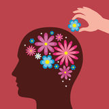 Woman with flowers in head and hand adding flower Royalty Free Stock Photo