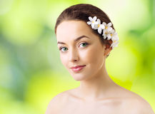woman with flowers in her hair Stock Image