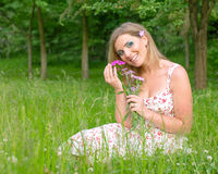 Woman with flowers in nature Stock Image