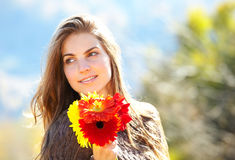 Woman with flowers outdoor Royalty Free Stock Images