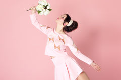 Woman With Flowers In Pink Stock Images