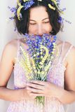 Woman and flowers. royalty free stock photography