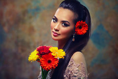 Woman with flowers portrait Stock Images