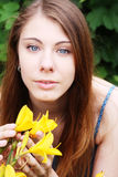 Woman with flowers posing in summer park Stock Photography
