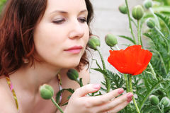 Woman with flowers posing in summer park Stock Photos