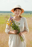 Woman with flowers posy. Outdoor portrait of   woman with flowers posy Royalty Free Stock Photography