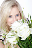 Woman with flowers Stock Photography