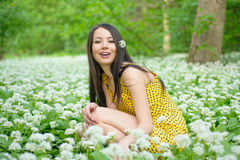 Woman among the flowers Stock Photography