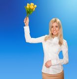 Business woman with flowers Royalty Free Stock Photo
