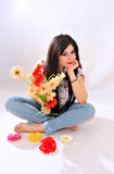 Woman with flowers smiling Royalty Free Stock Image