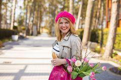 Woman with flowers smiling Stock Images