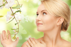 Woman with flowers on twig and butterflies Stock Photos