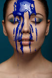 Woman with flowing blue paint Royalty Free Stock Images