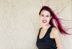 Woman With Flowing Magenta Hair Stock Image
