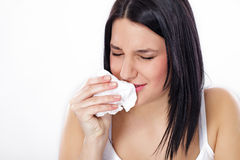 Woman with flu or allergy. Young woman sneezing, flu or allergy symptoms Stock Images