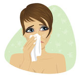 Woman with flu or allergy sneezing into her handkerchief Royalty Free Stock Images