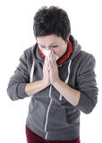 Woman with the flu blowing her nose Stock Image