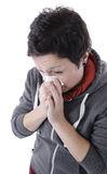 Woman with the flu blowing nose Stock Image