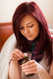 Woman with flu drinking syrup Royalty Free Stock Photo