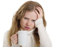 Woman with the flu and headache, a mug of tea Stock Photography
