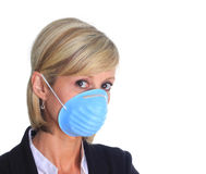 Woman with flu mask. Woman with a mask as protection again the influenza virus Stock Image